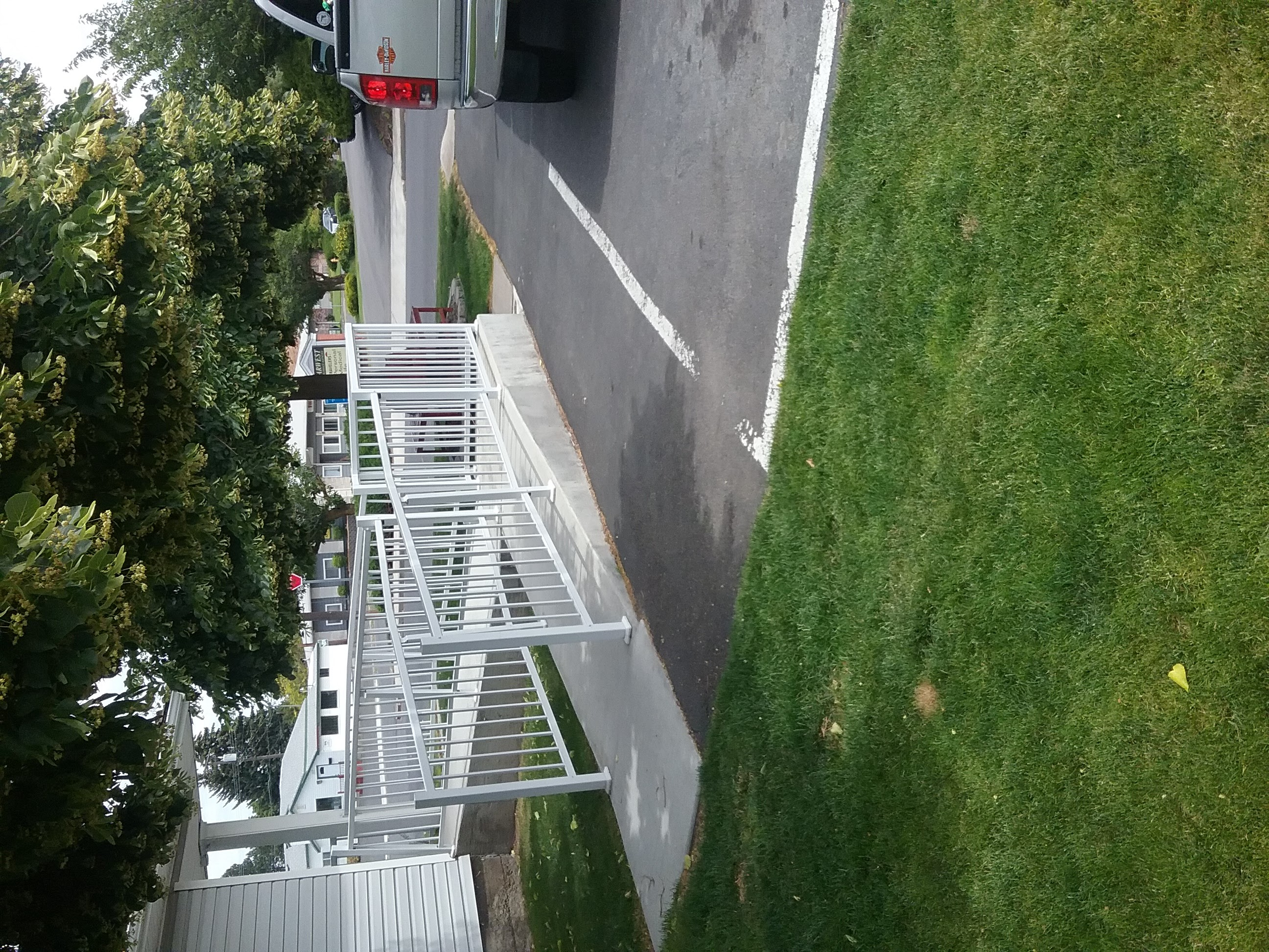 New ramp constructed on south side of building from parking lot to front door on east side of building