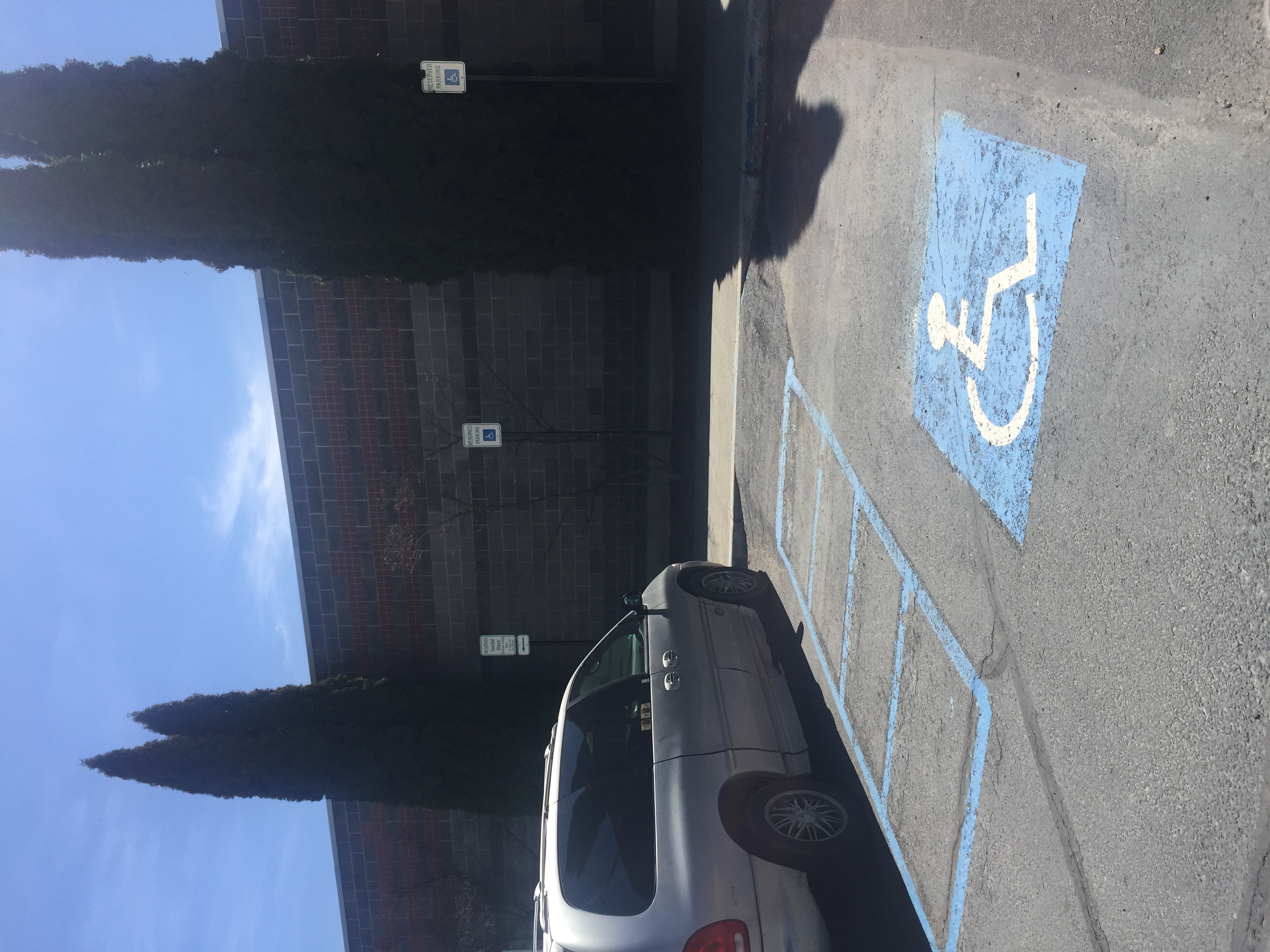 Two accessible parking spaces on the north side of the Vandal Store.