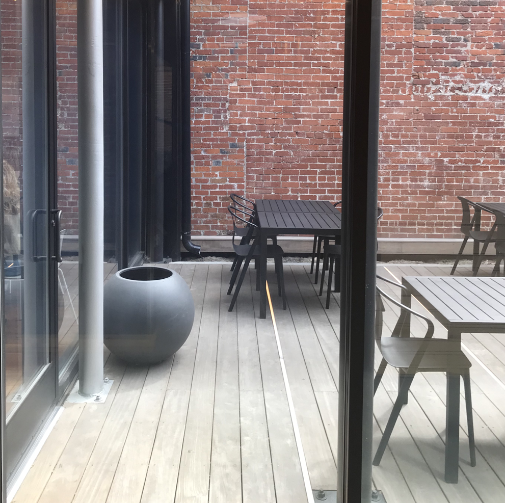 Outdoor patio located in middle of restaurant. The front patio is not accessible due to a lip