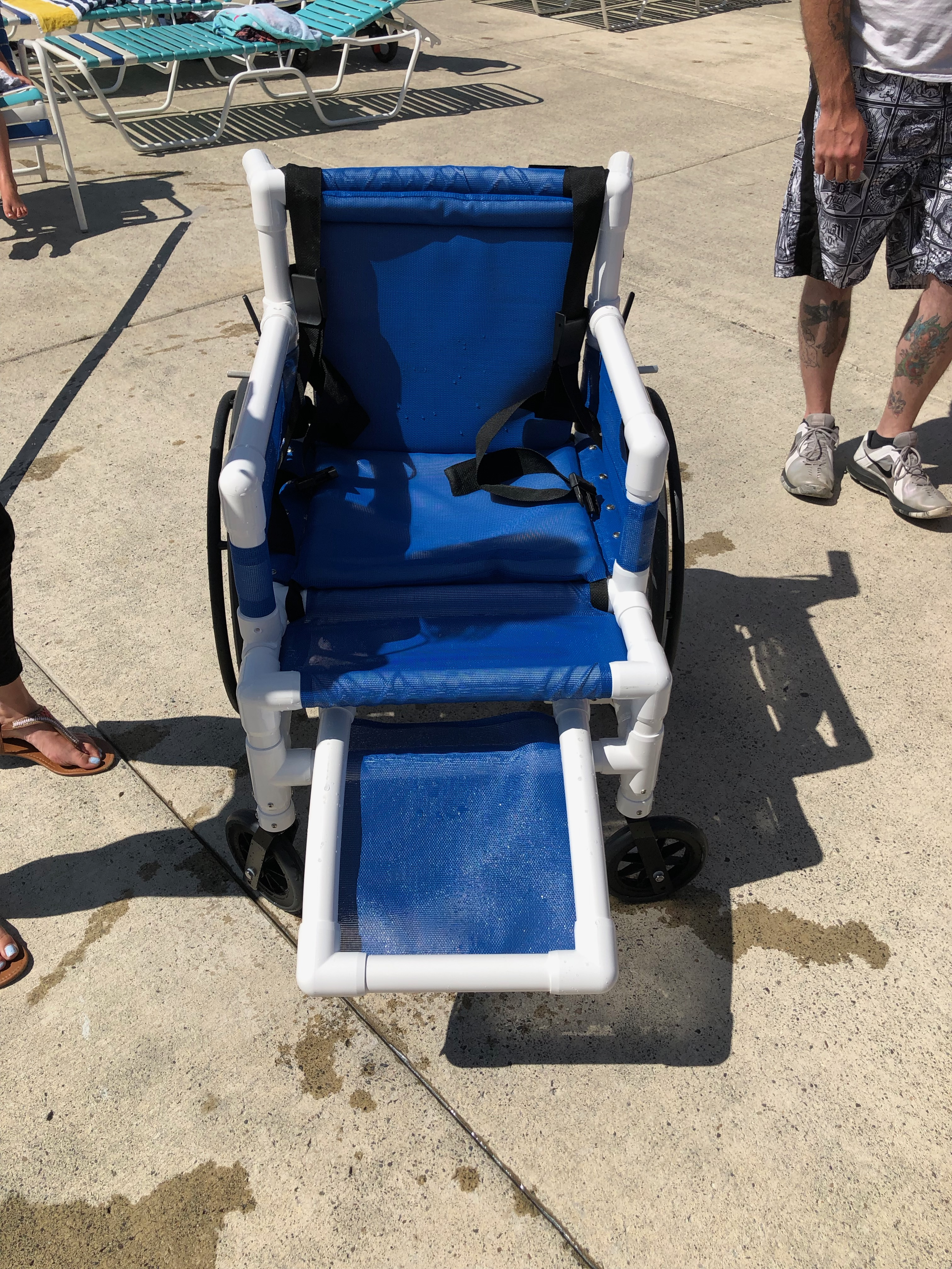 Aquatic wheelchair with removable foot rest