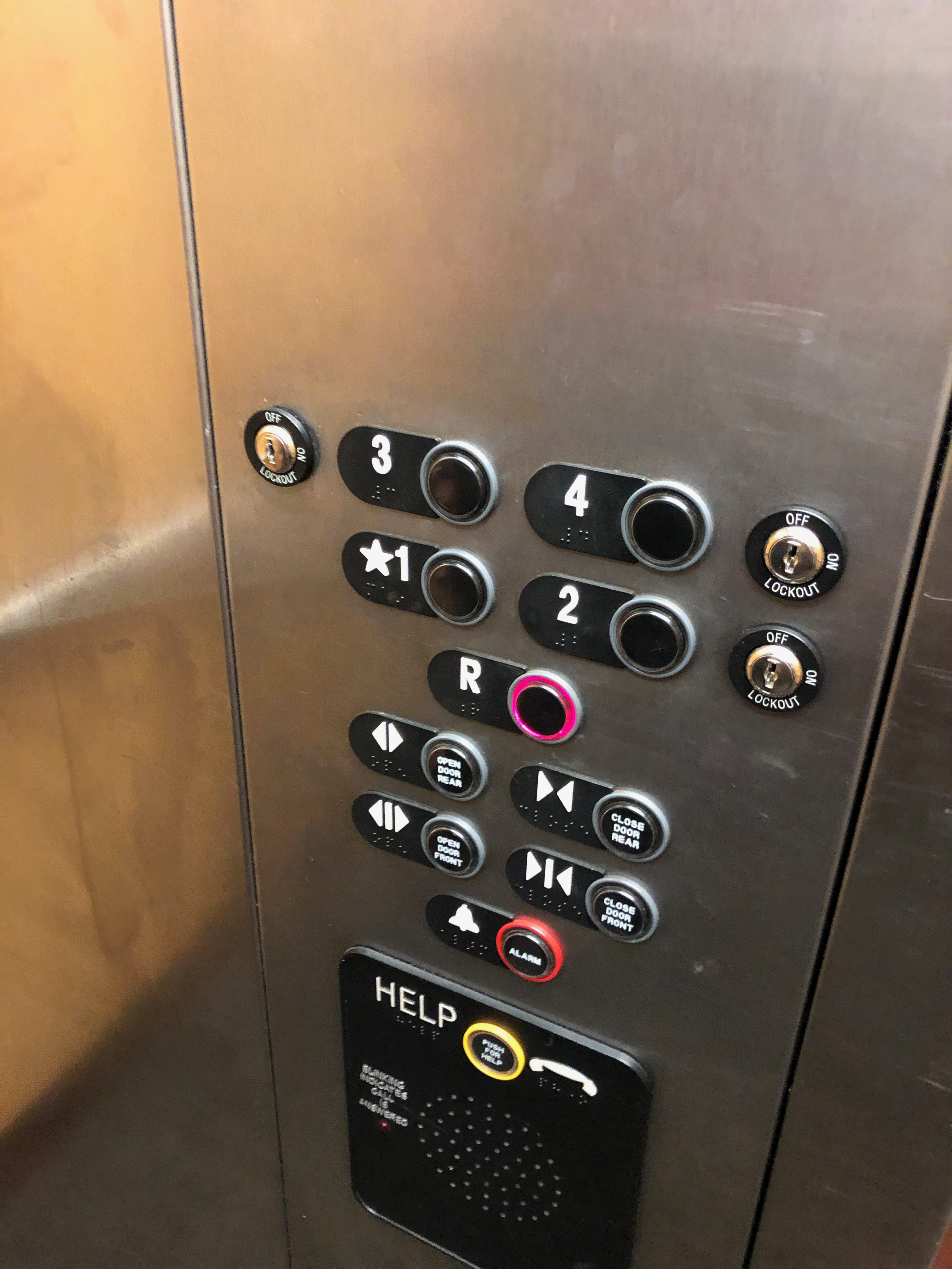 elevator control panel with Braille