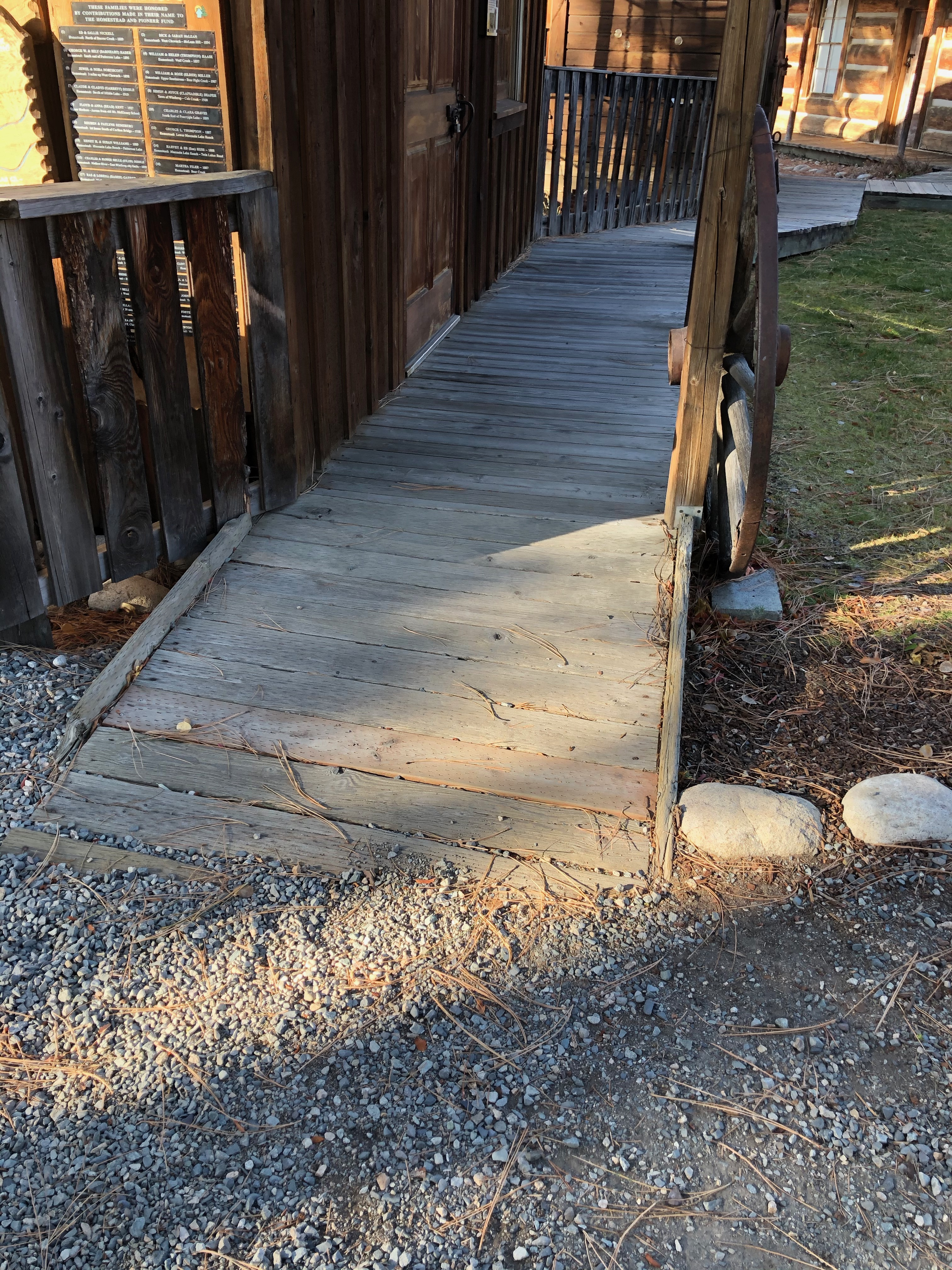 wooden ramp to a sidewalk